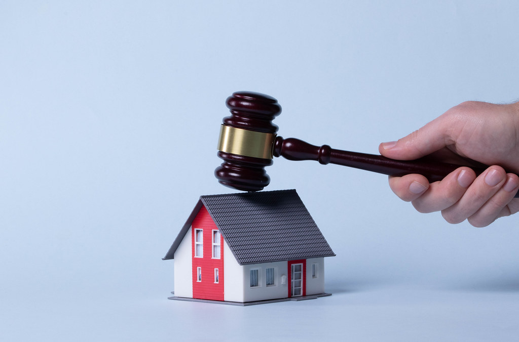 Judge gavel over a house