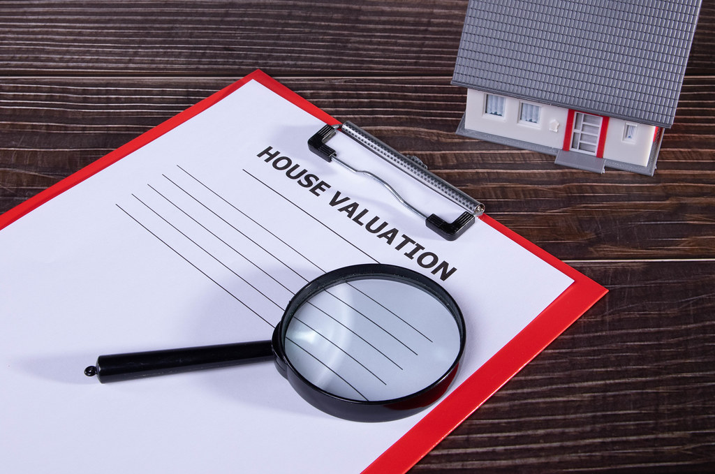 House valuation document on wooden table