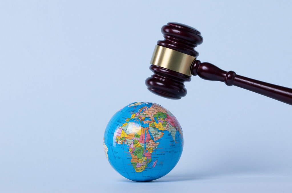 Judge gavel over a globe