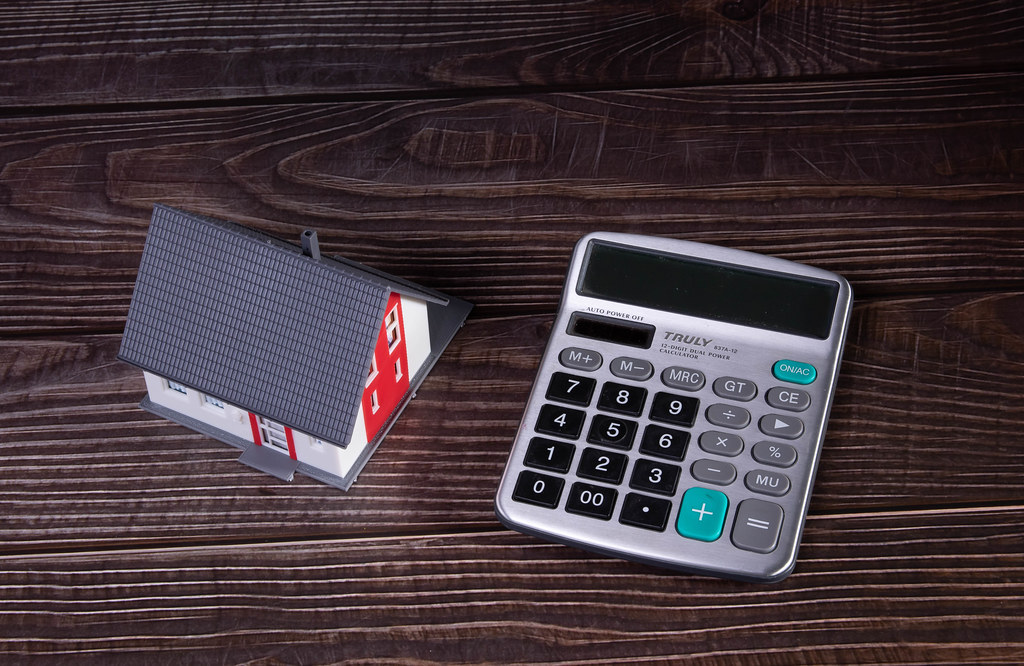 House with calculator on wooden table