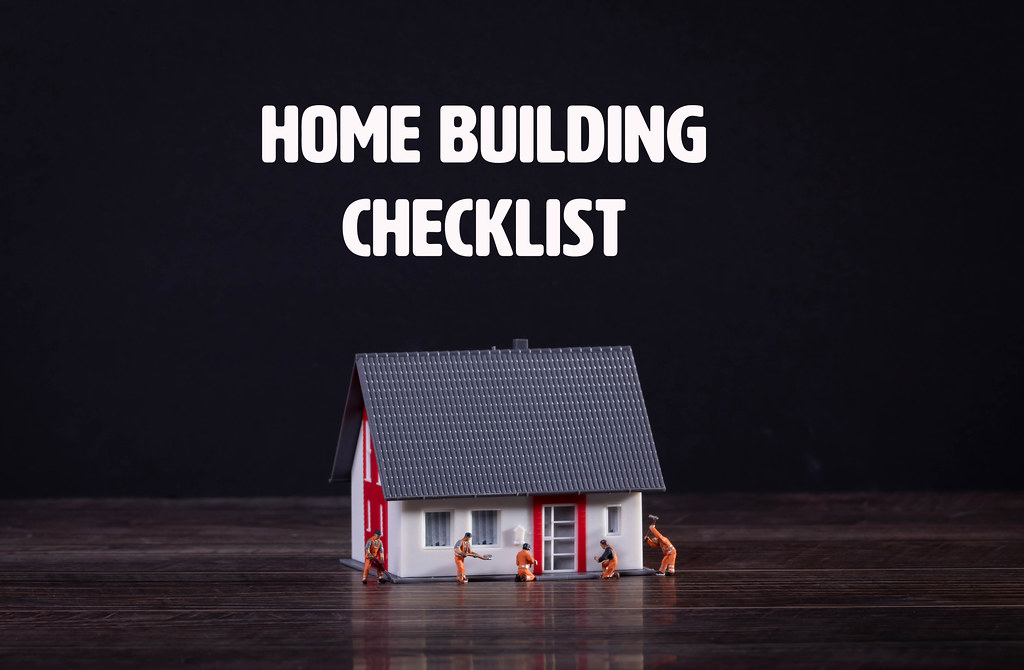 House with miniature workers and Home Building Checklist text
