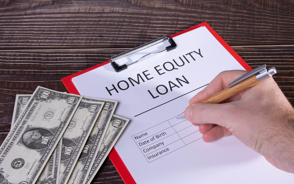 Man filling out Home equity loan document