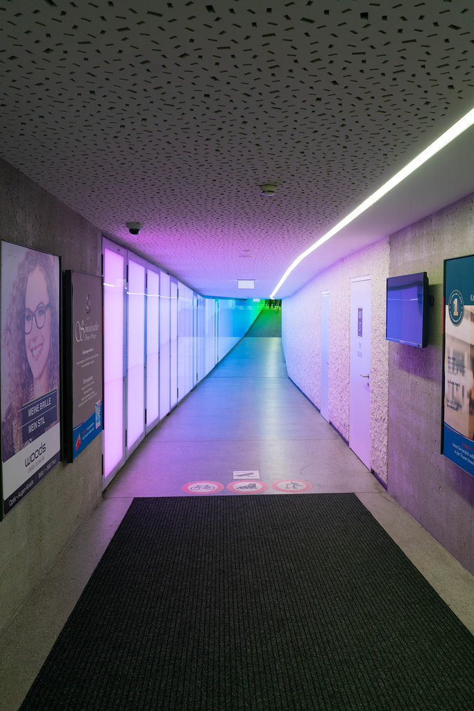 Square passage to shopping center with vivid purple gradient lighting