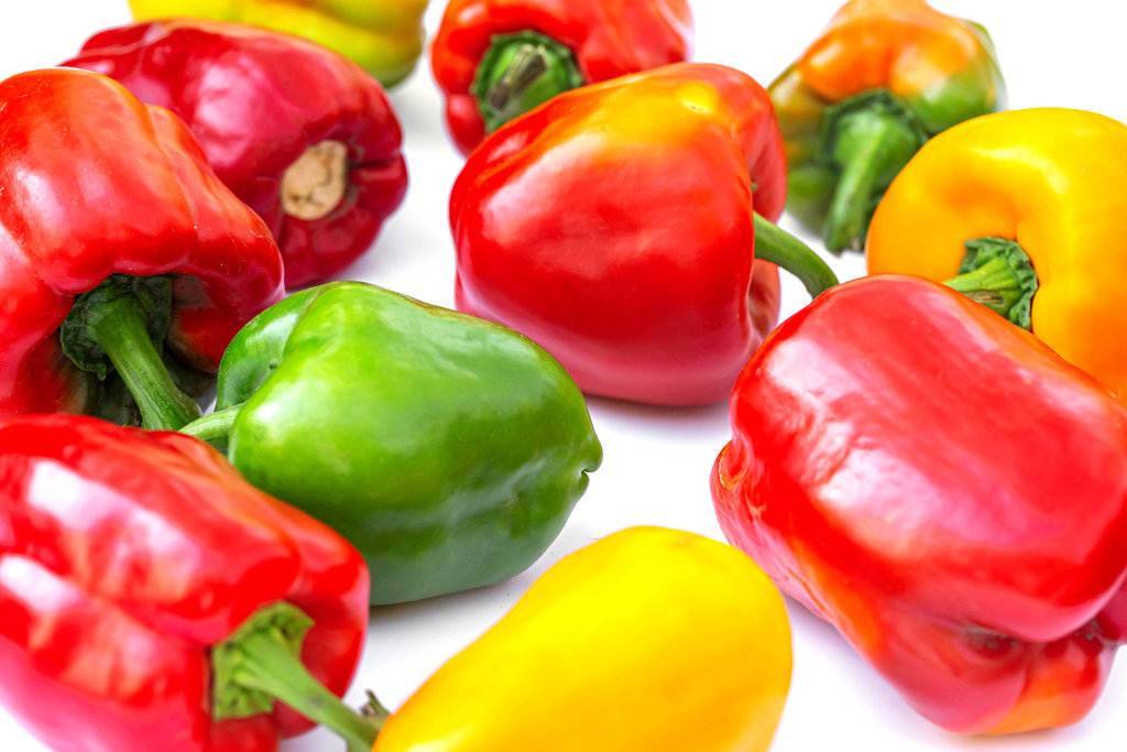 Multicolored sweet peppers background