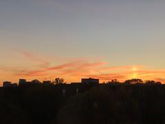 Brilliant orange sunset, glimpse of Rosslyn at 2500 Q Street NW, Georgetown, Washington, D.C.