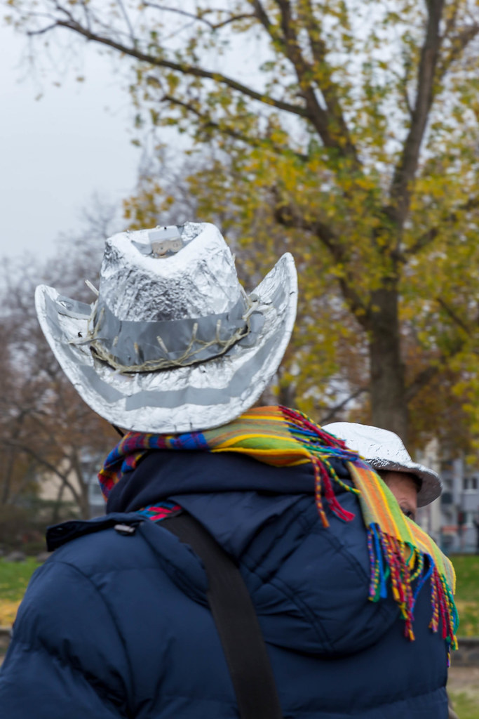 Cologne: man with tinfoil cowboy hat at conspiracy theorists' anti-lockdown meetup during the pandemic