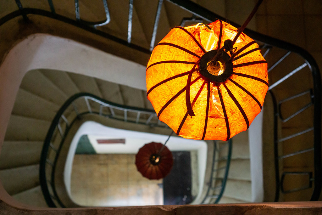 Bokeh Photo of Hanging Lantern Light in a Spiral Staircase in a Building in Vietnam