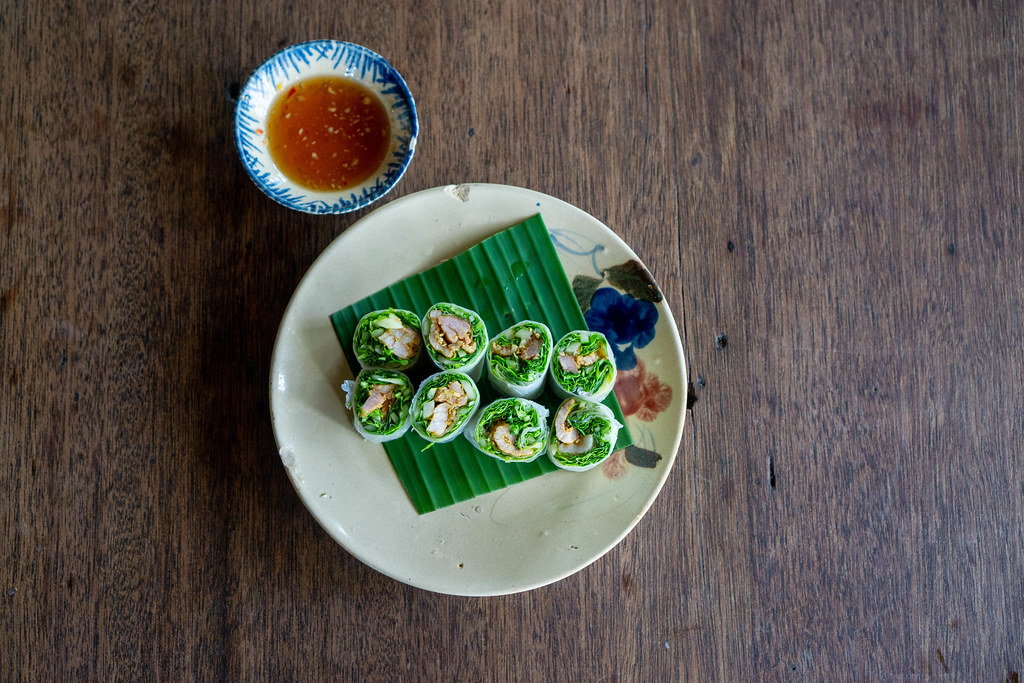 Top View Food Photo of Vietnamese Goi Cuon - Fresh Sommer Rolls on a Plate with Fish Sauce
