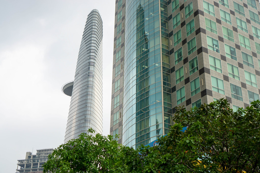 Bitexco Financial Tower next to unfinished Saigon One Tower seen from Nguyen Hue Walking Street in Ho Chi Minh City, Vietnam