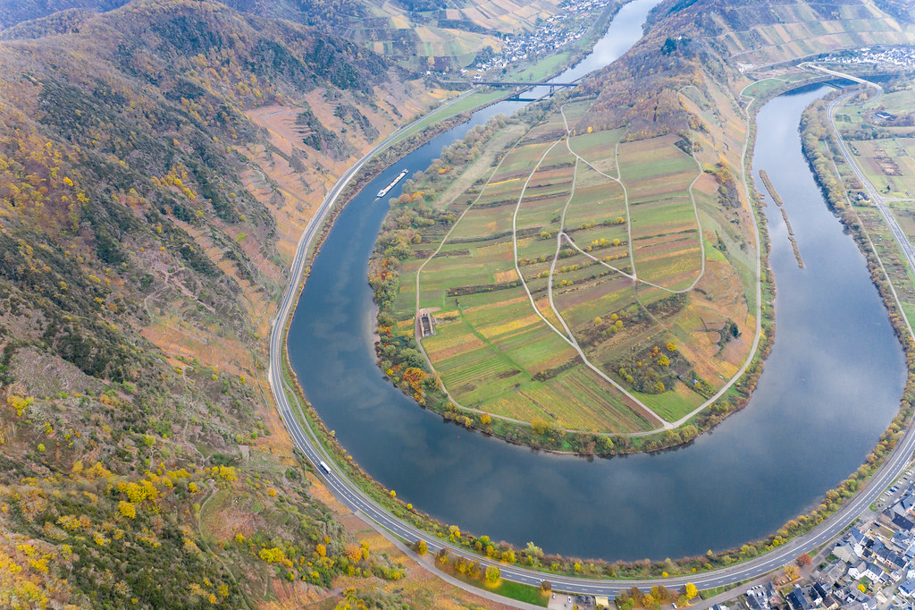 Aerial Drone Photo of Cargo Ship on Moselle River at Moselschleife with Hill Calmont and Town Bremm in Germany