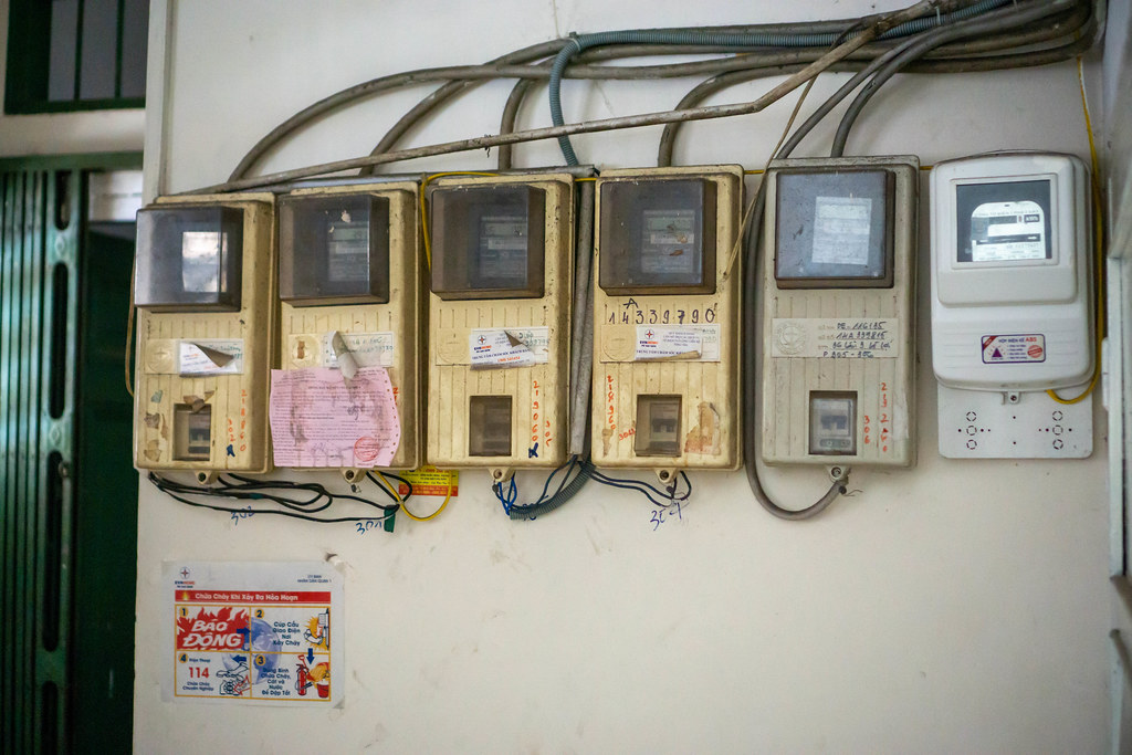 Old and New Electricity Meter on a Wall in a Residential Buidling in Ho Chi Minh City, Vietnam