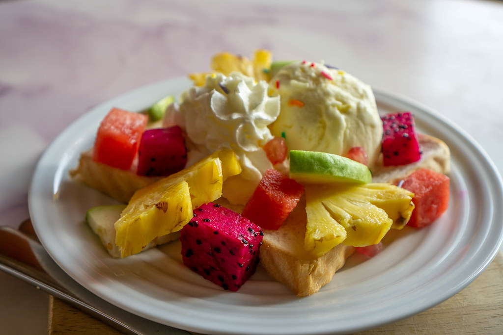 Close Up Food Photo of Plate of Fresh Fruits and Vanilla Ice Cream on a Slice of Toast