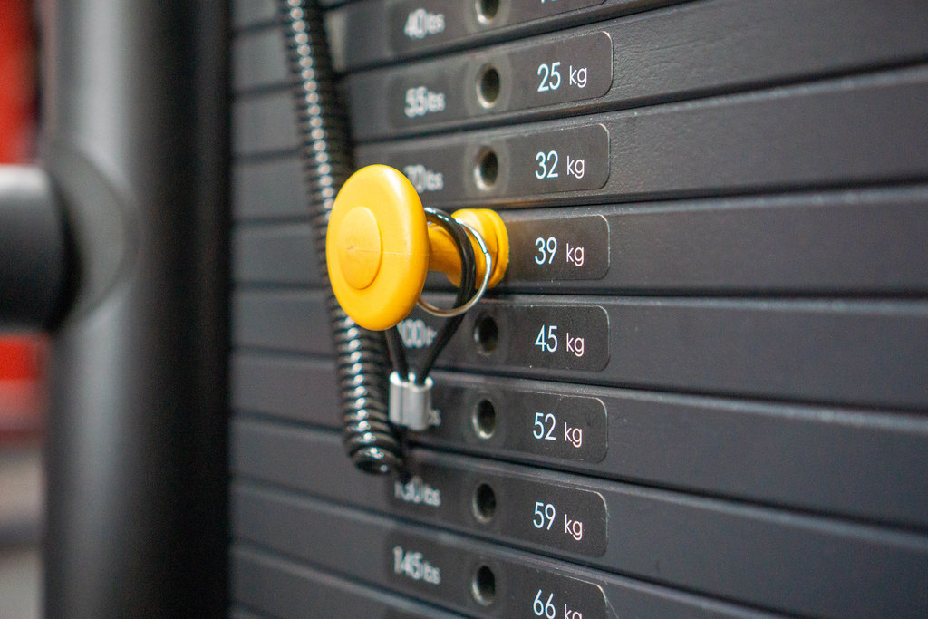 Close Up of Adjustable Steel Weight Stack of a Weightlifting Machine in a Gym