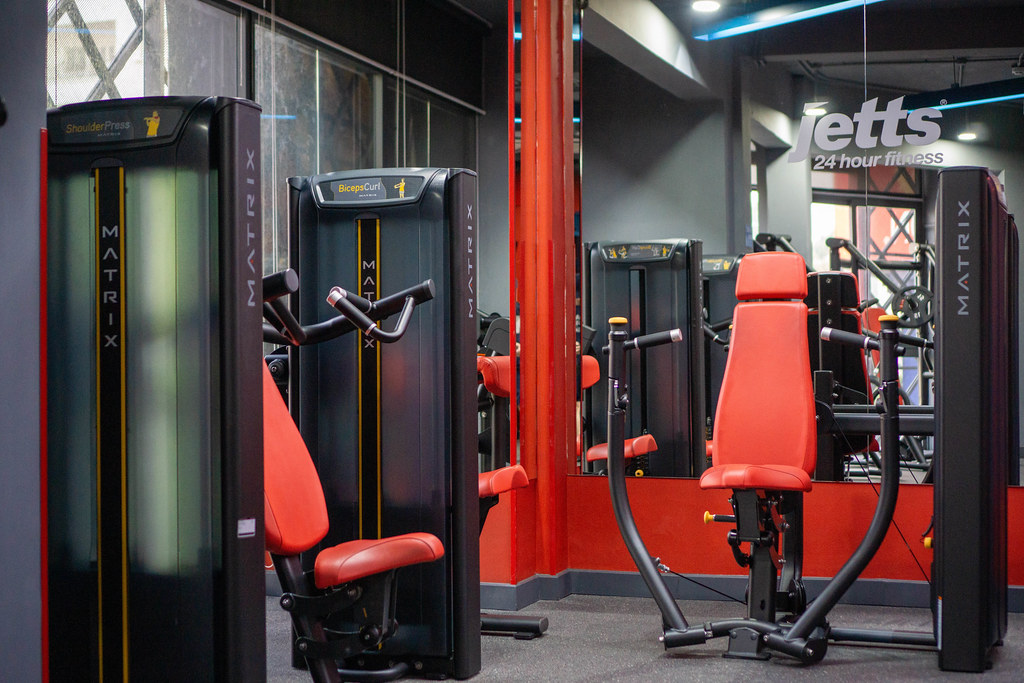 Straight Chest Press Machine, Biceps Curl Machine and Shoulder Press Machine in a modern Fitness Centre