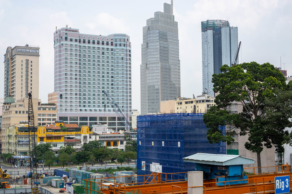 View of Nguyen Hue Walking Street, Caravelle Hotel, Sheraton and the Construction of Hilton Hotel Saigon in Ho Chi Minh City, Vietnam