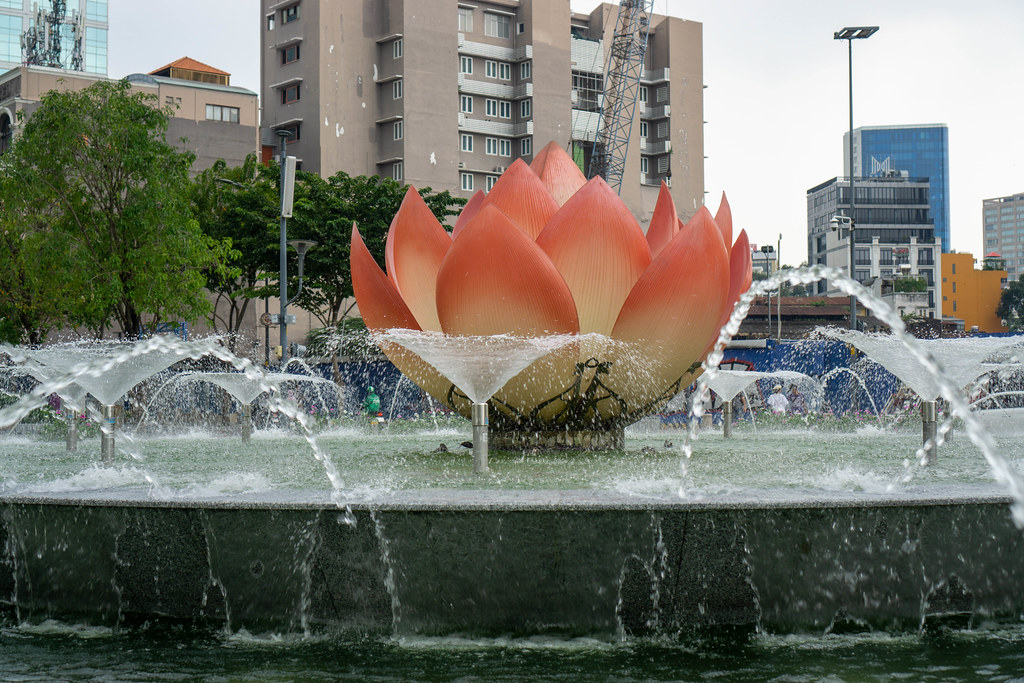 Close Up Photo of Giant Pink Lotus Flower with Water Fountain at Nguyen Hue Walking Street in Saigon, Vietnam