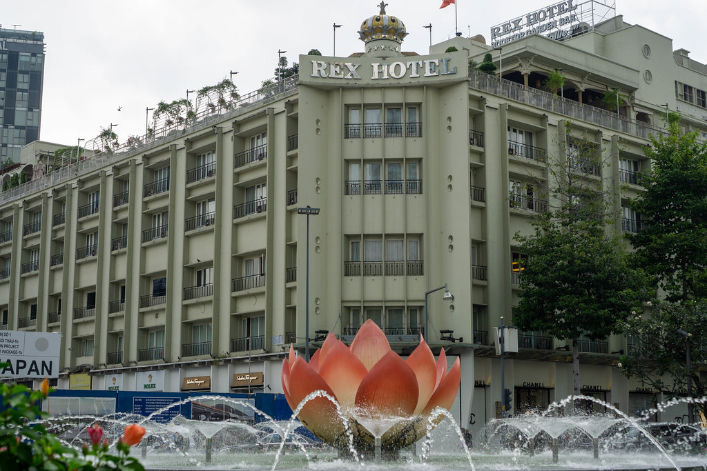 Water Fountain with Pink Lotus Flower with Iconic and Luxury Rex Hotel in the Background in Ho Chi Minh City, Vietnam