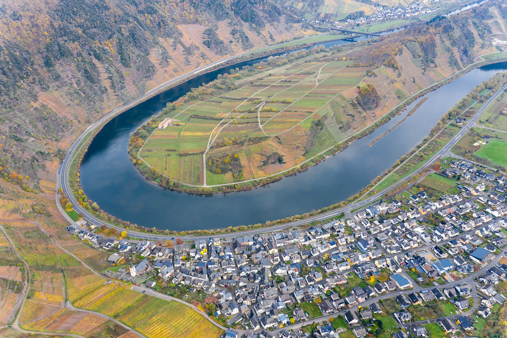 Drone Shot of Moselle Valley with Historical Landmark Kloster Ruine Stuben, Moselschleife, Hill Calmont and Municipality Bremm in Germany