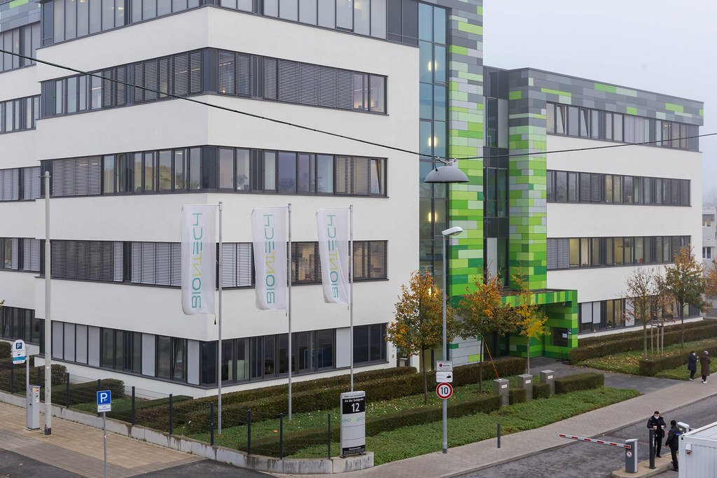 People walking around the Headquarters of BioNTech Company in Mainz, Germany
