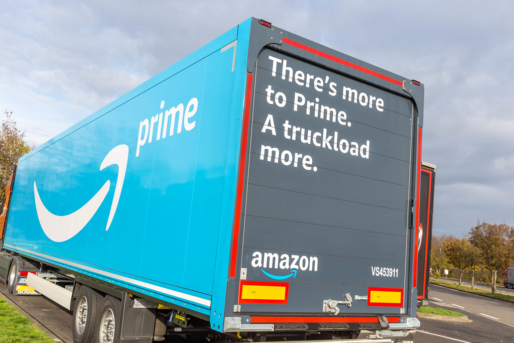 Amazon Prime Truck with Words 'There's more to Prime. A truckload more.' printed on it parking at a Rest Stop in Germany