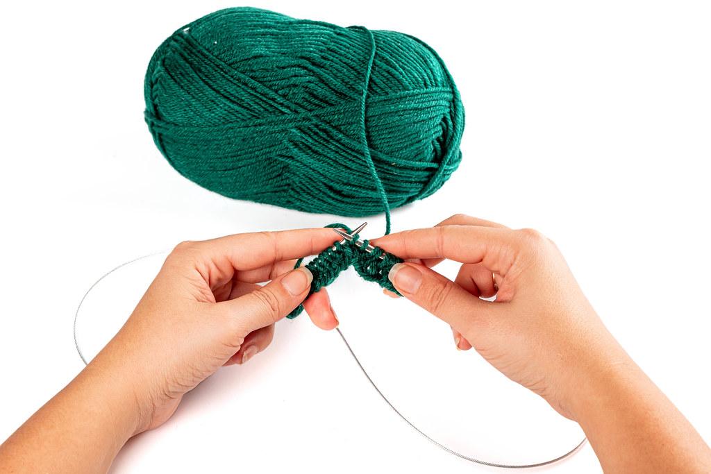 Close-up, women's hands knitting needles