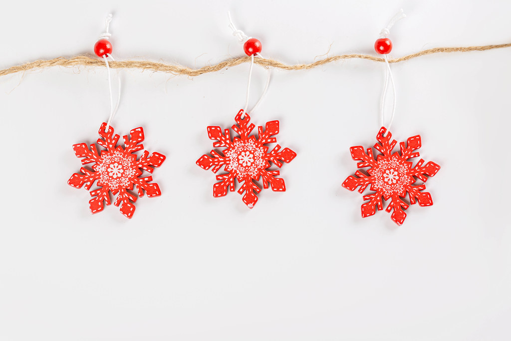 Red snowflakes christmas decor on a rope