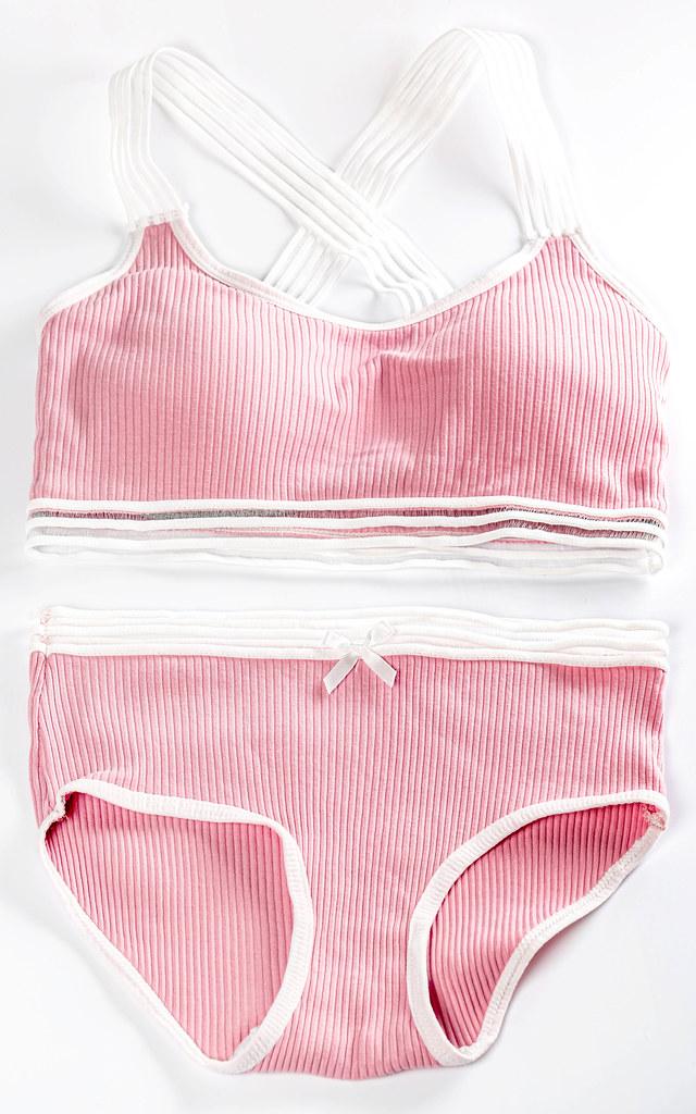 Pink sports lingerie set on white