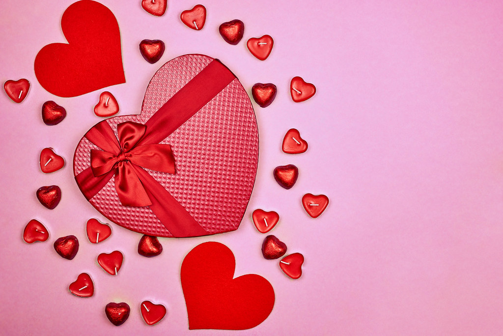 A big heart-shape candy box on red
