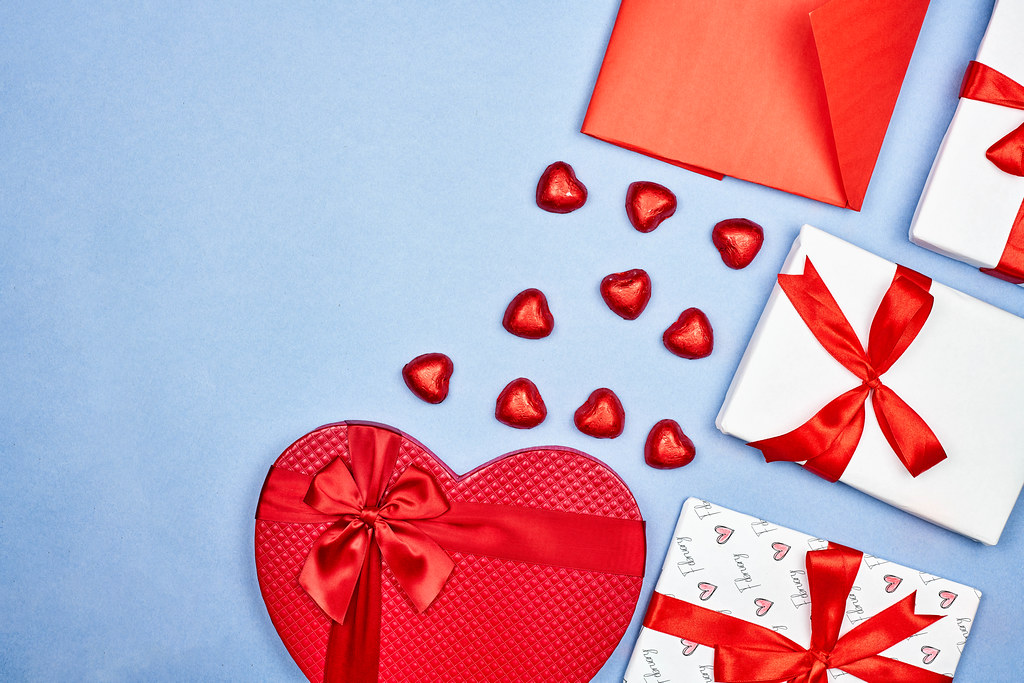 Valentine's day flat lay with gift boxes and sweet candies