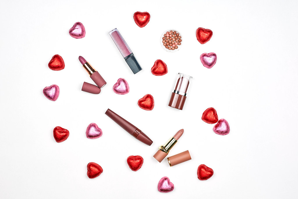 Set of various lipstick collections with sweet candies