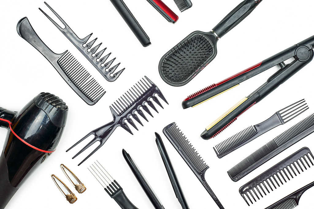 Top view of professional hairdresser set on white