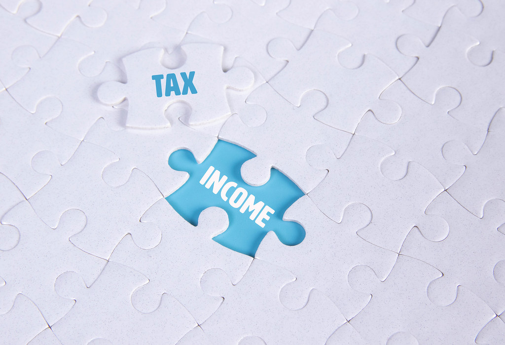 White puzzle with word Tax & Income