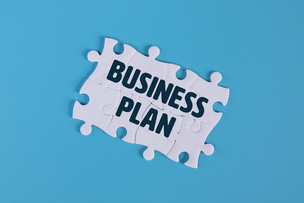 Puzzle pieces with Business Plan text
