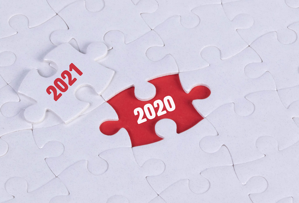 Puzzle pieces and change between 2020 and 2021 concept
