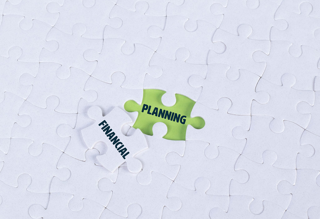 White puzzle with word Planning & Financial