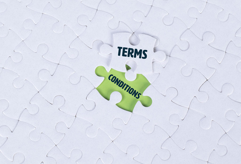 White puzzle with text Terms & Conditions