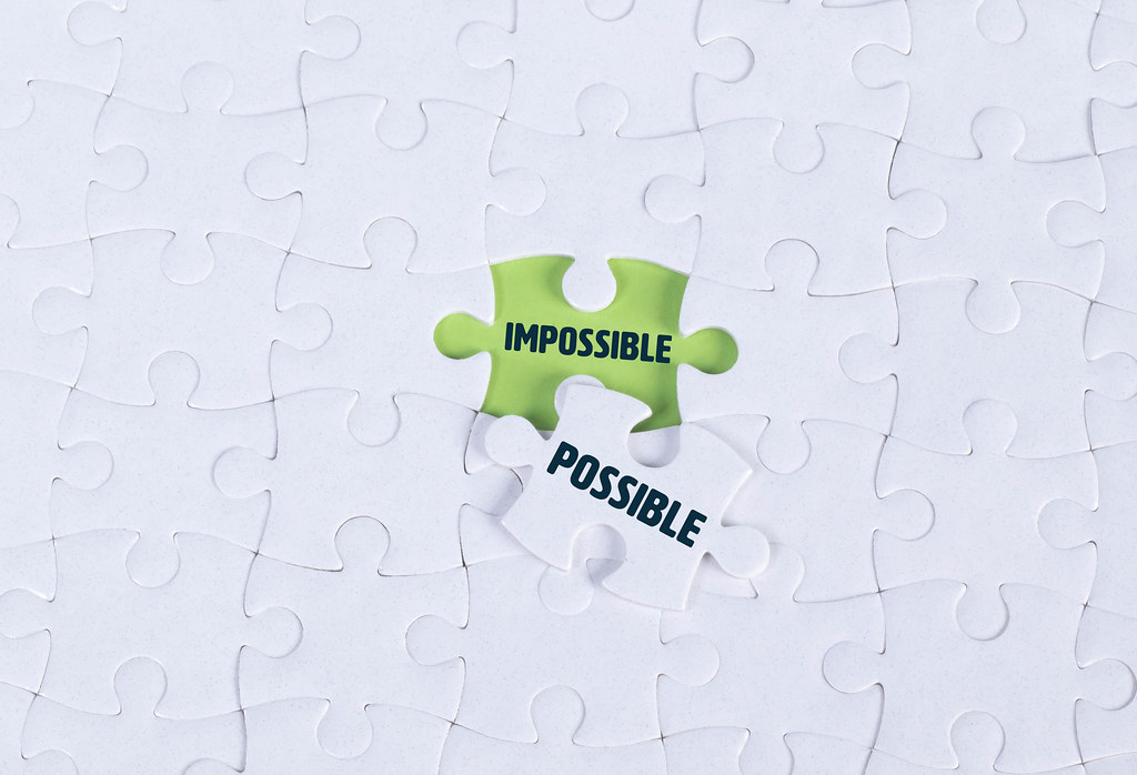 White puzzle with word Impossible & Possible