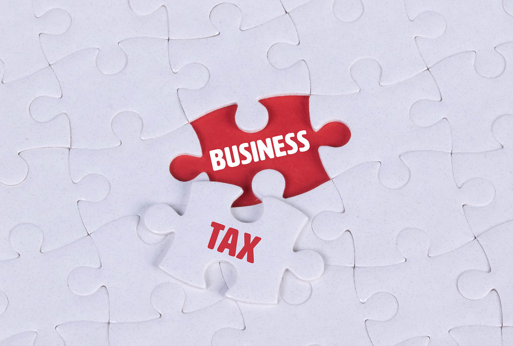 White puzzle with word Business & Tax