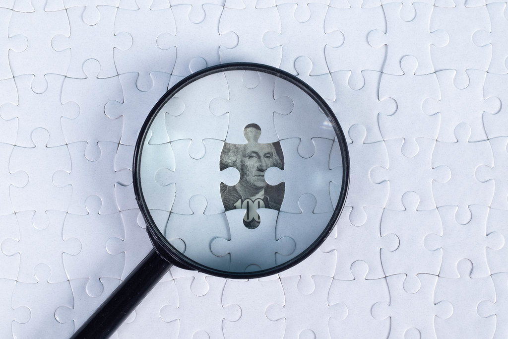 Magnifier and puzzle on money