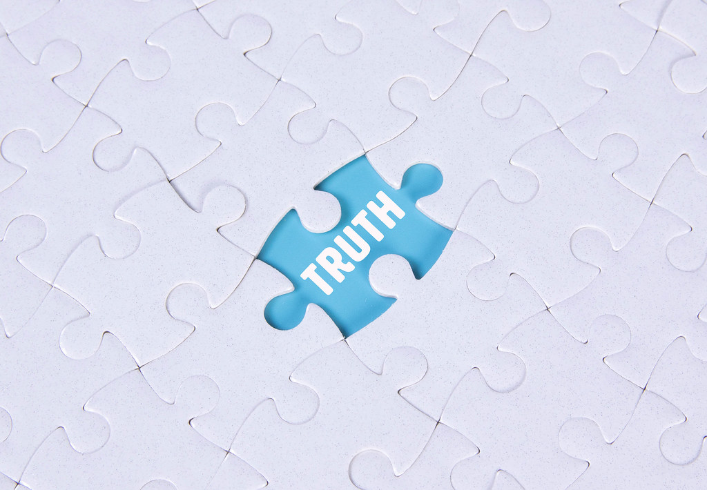 Missing puzzle piece with Truth text