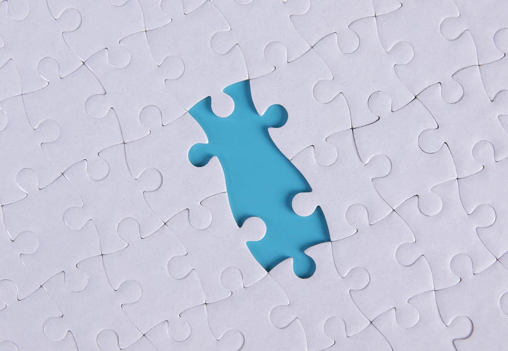 Jigsaw puzzle with two missing pieces