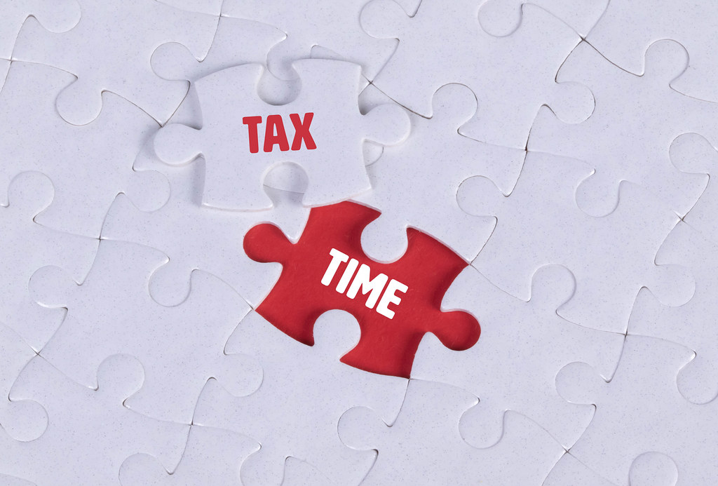 White puzzle with word Tax & Time