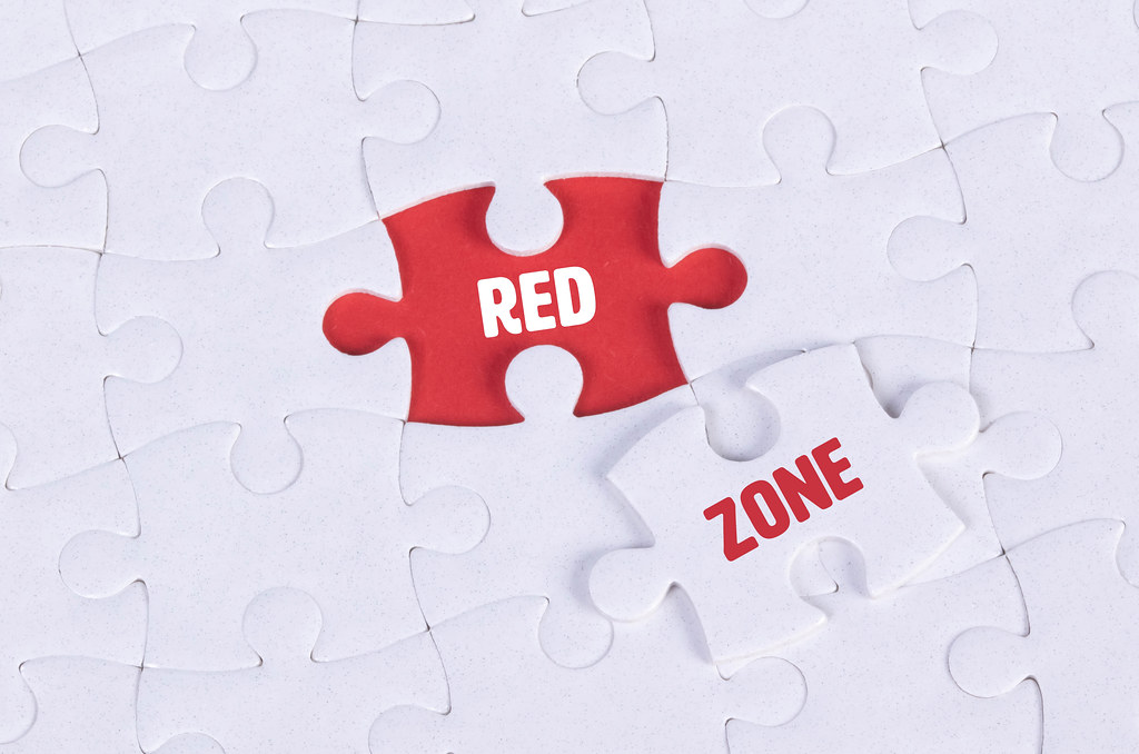 White puzzle with word Red & Zone