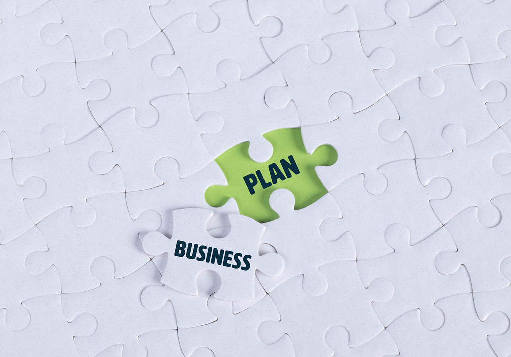 White puzzle with word Business & Plan