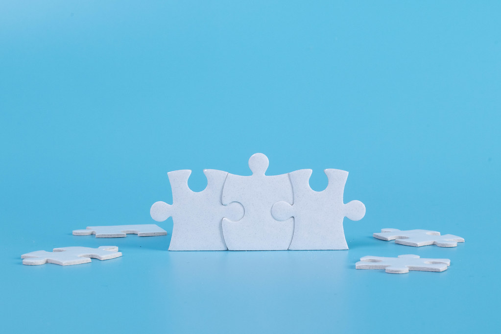 Connected jigsaw puzzle pieces on blue background