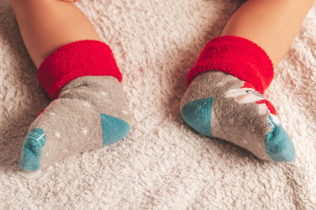 Baby feet in Christmas socks