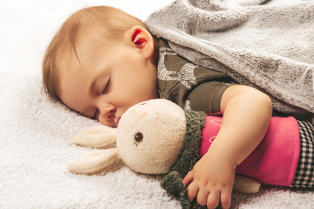Little boy sleeping hugging his toy