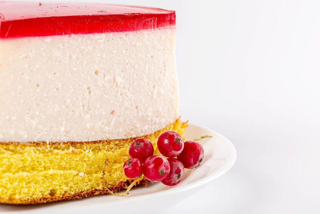 Cheesecake with red currant berries, close-up
