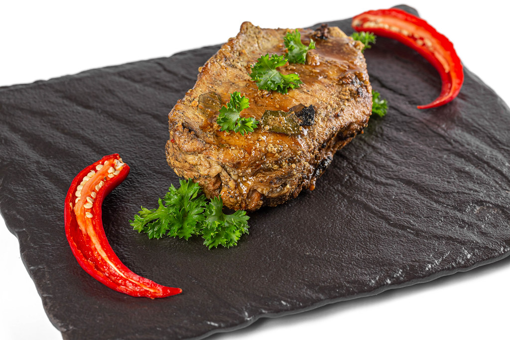 Baked meat with fresh chili pepper