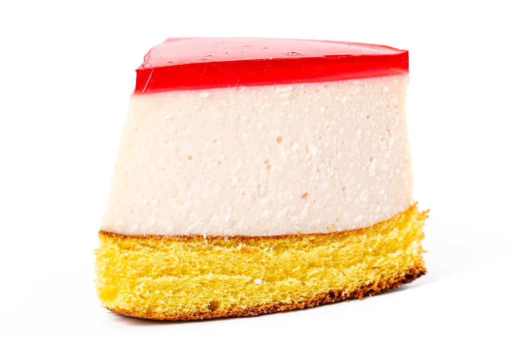 Close-up, a portion of cheesecake on a white background
